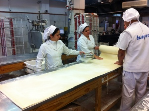 Team folding the dough