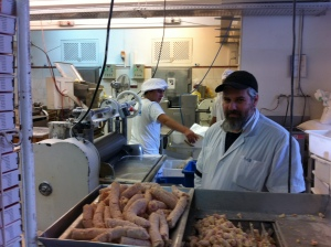 Moshe keeping an eye on those sausages