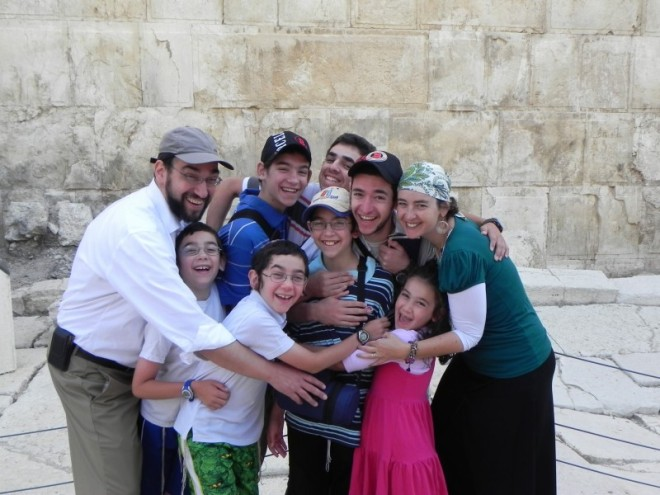 Try getting a family picture this close to the Kotel.