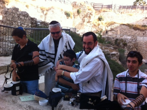 Putting Tefillin on my son Netanel for the first time.